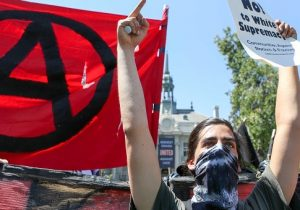 Antifa members and counter protesters gather during an event at Martin Luther King Jr. Park in Berkeley, Calif. / Getty Images