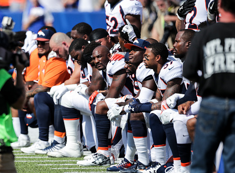 Denver Broncos players kneel during the American National Anthem before an NFL game against the Buffalo Bills on September 24, 2017 / Getty Images