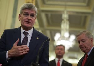 Sen. Bill Cassidy speaks as Sen. Dean Heller and Sen. Lindsey Graham listen during a news conference on health care