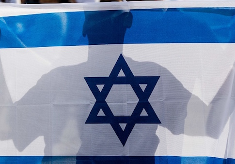 An Israeli man holds his country's national flag