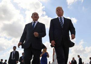 Israeli Prime Minister Benjamin Netanyahu speaks with President Donald Trump in Tel Aviv on May 23