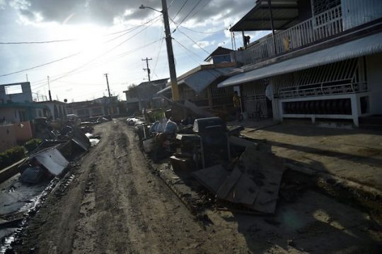 Furniture damaged by Hurricane Maria and debris are seen on a street in Toa Baja, Puerto Rico