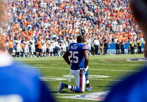 LeSean McCoy #25 of the Buffalo Bills takes a knee during the national anthem / Getty Images