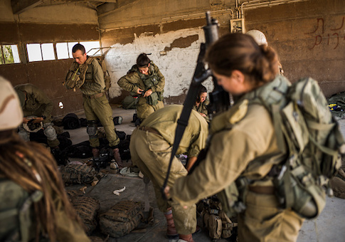 IDF soldiers prepare for a day of combat practice
