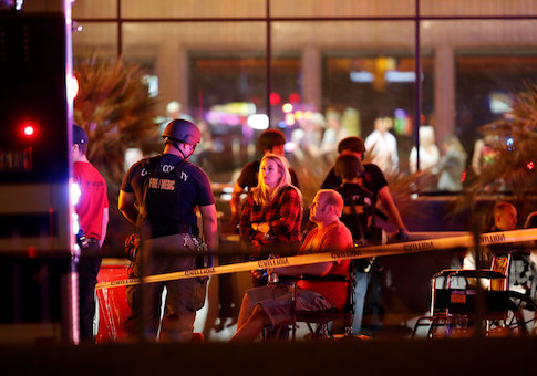 People wait in a medical staging area on October 2, 2017, after a mass shooting during a music festival in Las Vegas
