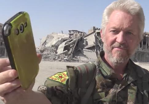 British actor Michael Enright playing Ariana Grande's song 'Bang Bang' in Raqqa, Syria
