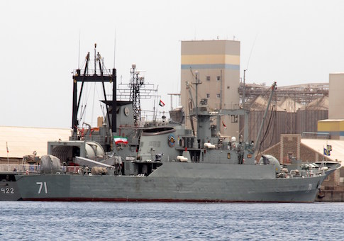 Iranian military frigate and light replenishment ship are seen docked for refueling