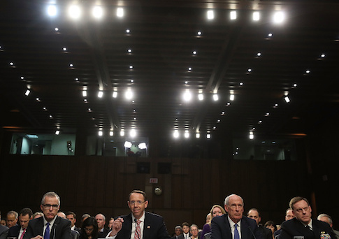 Acting FBI Director Andrew McCabe, Deputy Attorney General Rod Rosenstein, Director of National Intelligence Dan Coats, and National Security Agency Director Adm. Michael Rogers appear before the Senate Intelligence Committee