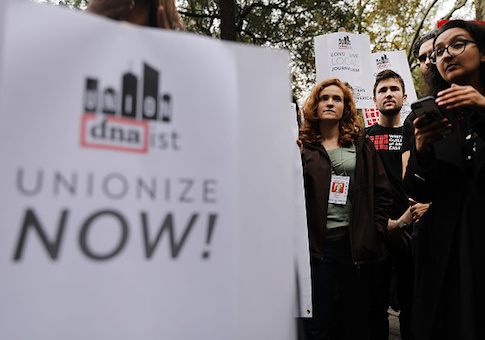 Writers, journalists, labor activists and DNAinfo and Gothamist employees attend an afternoon rally at City Hall Park hosted by the Writers Guild of America to support the journalists and other staff members who lost their jobs at the publications after they voted to form a union