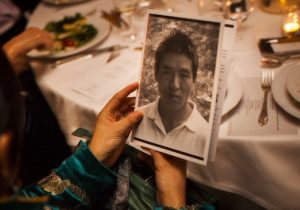 The wife of imprisoned Tibetan journalist Dhondup Wangchen holds a petition for her husband at the Committee to Protect Journalists' International Freedom Awards Dinner