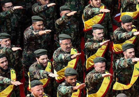 Members of Lebanon's Shiite Hezbollah movement salute