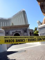 Police tape blocks an entrance at the Mandalay Bay Resort & Casino
