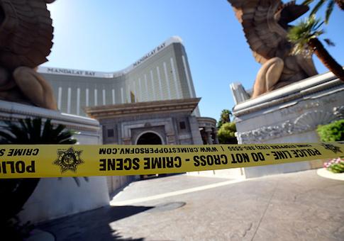 Police tape blocks an entrance at the Mandalay Bay Resort & Casino