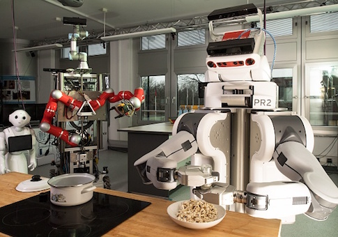A robot shakes salt over popcorn on March 8, 2017 at the Institute for Artificial Intelligence