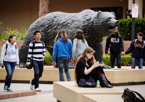 Students sit around the Bruin Bear statue during lunchtime on the campus of UCLA