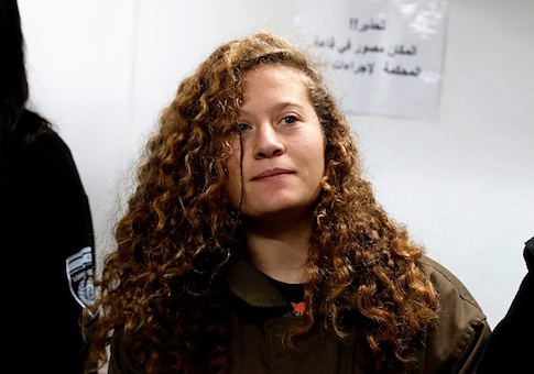Sixteen-year-old Ahed Tamimi stands for a hearing in the military court at Ofer military prison in the West Bank village of Betunia