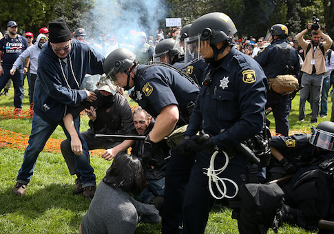 Police intervene as Trump supporters clash with protesters at a free speech rally in Berkeley, California