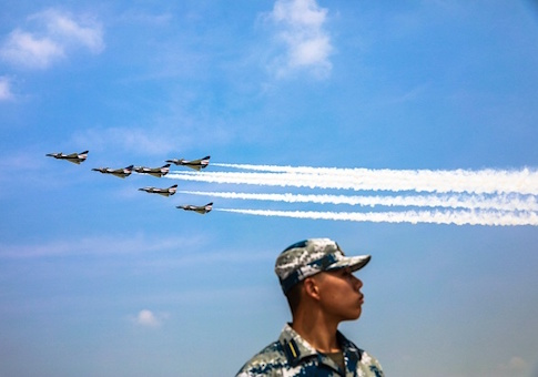 This photo shows China's Bayi Aerobatic Team performing in the sky during the Chinese People's Liberation Army Air Force Aviation Open Day