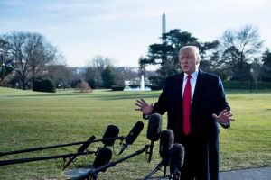 President Donald Trump talks to the press