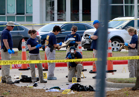Investigators work the crime scene outside of the Curtis Culwell Center after a shooting occurred