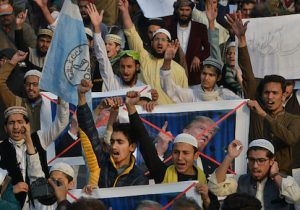 Pakistani demonstrators take part in a protest against U.S. aid cuts