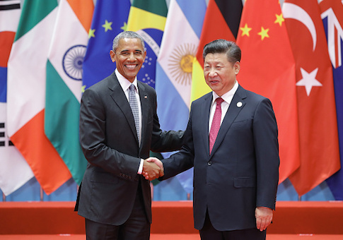 U.S. President Barack Obama shakes hands with Chinese President Xi Jinping