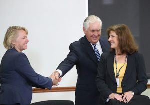 Secretary of State Rex Tillerson shakes hands with Susan Thornton
