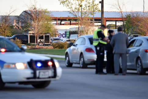 Law enforcement personnel attend the scene of a blast at a FedEx facility in Schertz