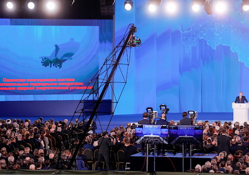 The video screen shows an unmanned nuclear-powered submersible as Russia's President Vladimir Putin delivers an annual address to the Federal Assembly of the Russian Federation