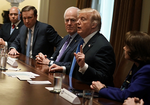 U.S. President Donald Trump speaks as Rep. Brian Mast, Sen. Christopher Murphy, Senate Majority Whip Sen. John Cornyn, and Sen. Dianne Feinstein listen during a meeting with bipartisan members of Congress