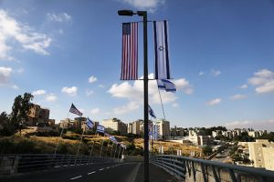 American and Israeli flags fly at the entrance to the new American embassy in Jerusalem