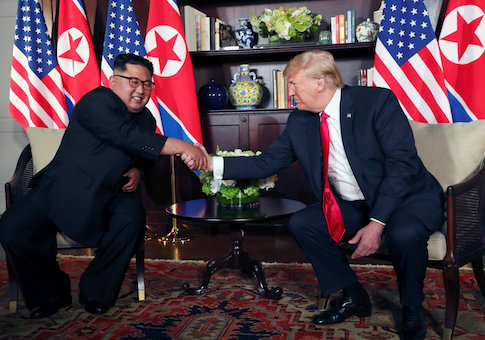 U.S. President Donald Trump shakes hands with North Korea's leader Kim Jong Un