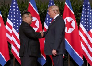 U.S. President Donald Trump shakes hands with North Korean leader Kim Jong Un