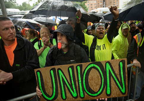 Construction workers and union members hold a rally in Columbus Circle in NYC