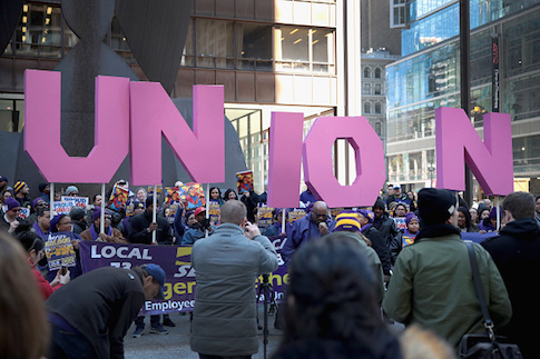 Members of the SEIU hold a rally