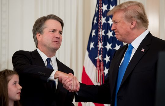 Brett Kavanaugh shakes hands with President Donald Trump