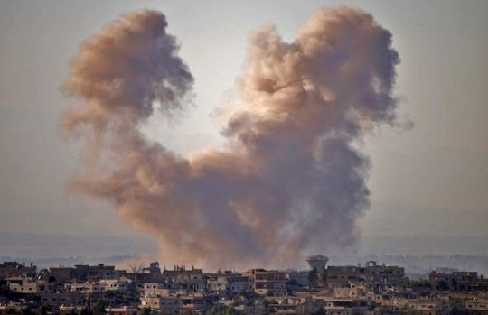 Smoke rises above opposition held areas of the Daraa province during airstrikes by Syrian regime forces