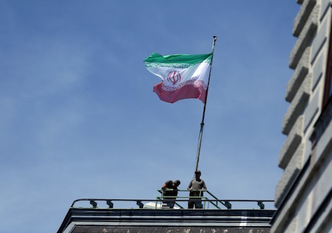 FILE PHOTO: The national flag of Iran is seen on top of the Austrian Chancellery during the visit of President Hassan Rouhani in Vienna