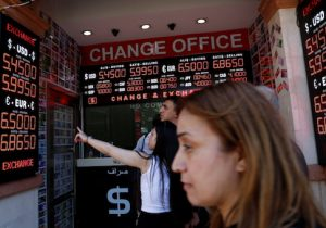 People check currency exchange rates at a currency exchange office in Istanbul