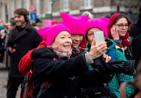 Women wearing the so-called Pussy Hat pose for a selfie