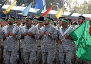 Iranian members of the Basij militia march during a parade