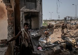 Yemeni fighters man a frontline position in an area which contains the main supply route linking Hodeidah city to the rebel-held capital Sanaa