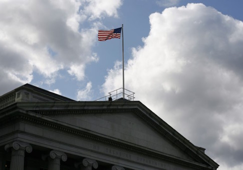 The United States flag flies atop the U.S. Treasury Department in Washington
