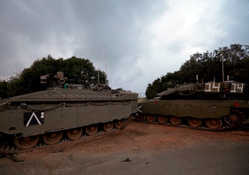 Israeli Merkava tanks parked near the border with Lebanon, after the area was declared a closed military zone by the Israeli army