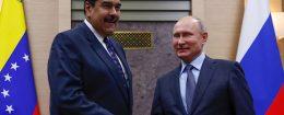 Russian President Vladimir Putin shakes hands with his Venezuelan counterpart Nicolas Maduro