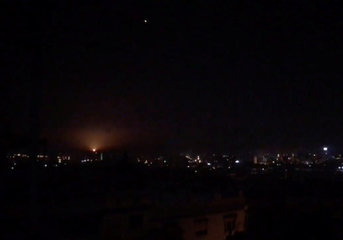 What is believed to be guided missiles are seen in the sky during what is reported to be an attack in Damascus, Syria