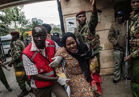 A woman is rescued from the Dusit Hotel
