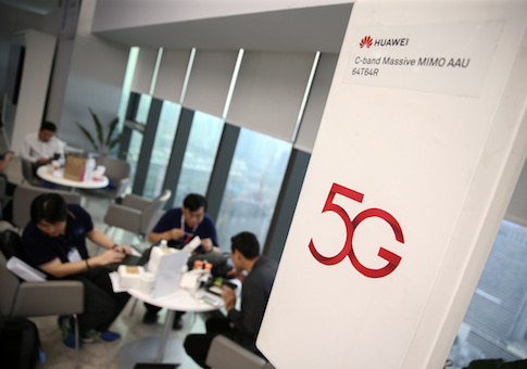 A Huawei 5G device is pictured outside an exhibition in Bangkok