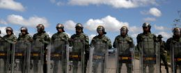 Venezuelan National guards block the road at the border between Venezuela and Brazil