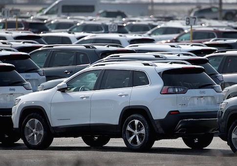 Jeep Cherokees sit on a lot at Fiat Chryslers's Belvidere Assembly Plant